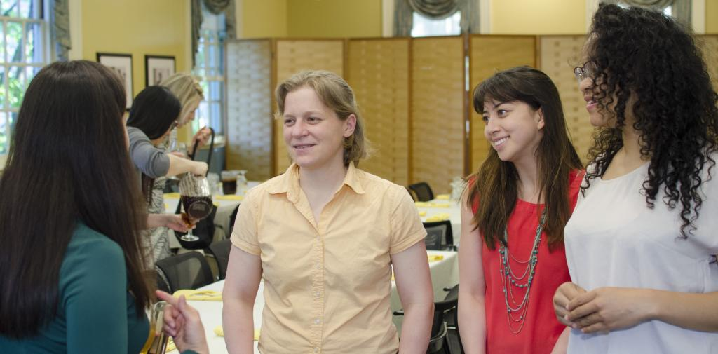 Jenny Hoffman converses with three students at Dudley House