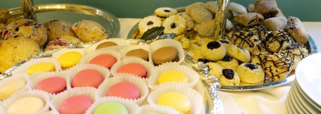 Sweets, including macaron and cookies, on multi-tier trays
