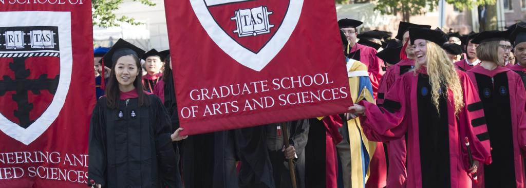 Graduates marching in street during Commencement