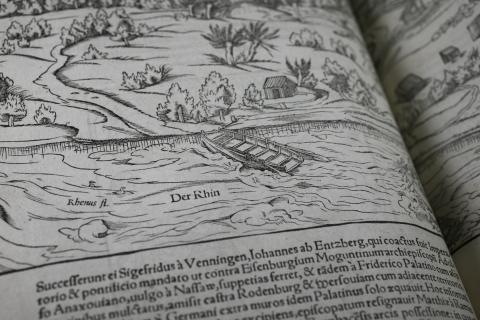 Detail from an etching of a city in Germany, with latin text below the illustration