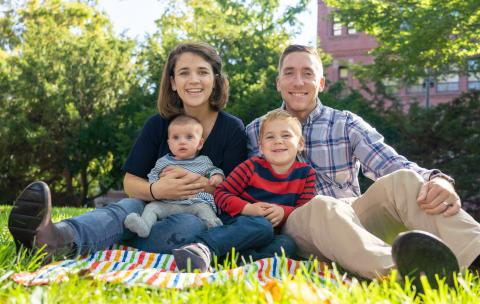 Blakely Bussie O'Connor with her husband and their two children sitting on grass