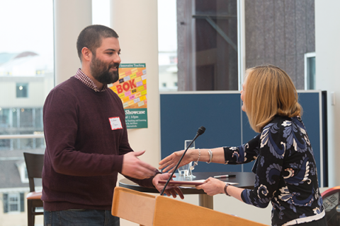Andrew Yegian shakes hands with Dean Emma Dench