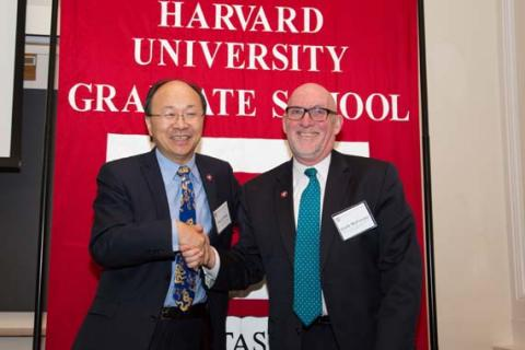 Dean Xiao Li Meng poses with a GSAS graduate at Alumni Day