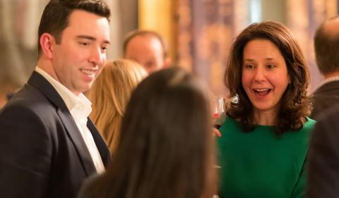 Alumni smiling at an event
