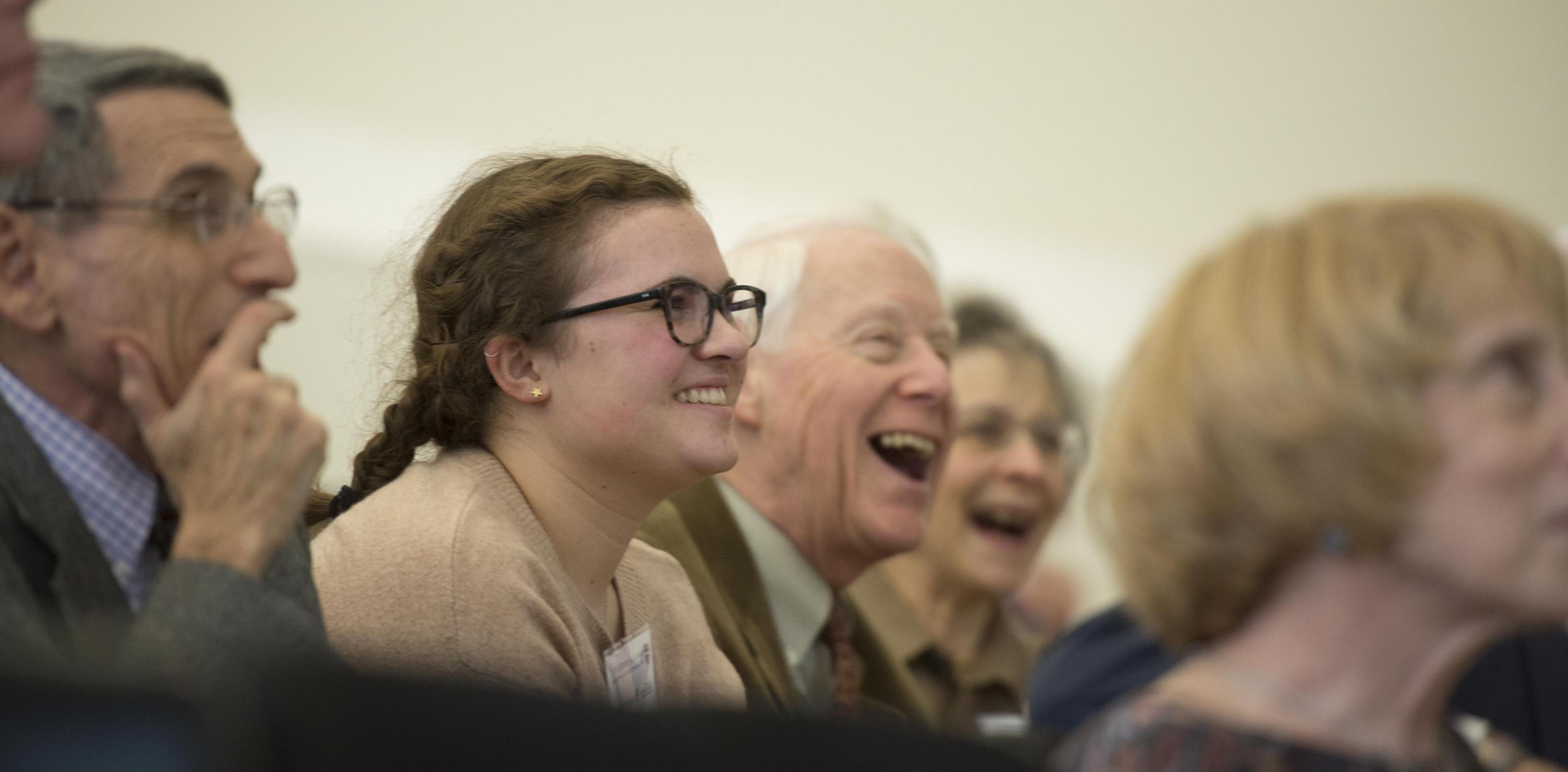 A group of people of various ages laughing