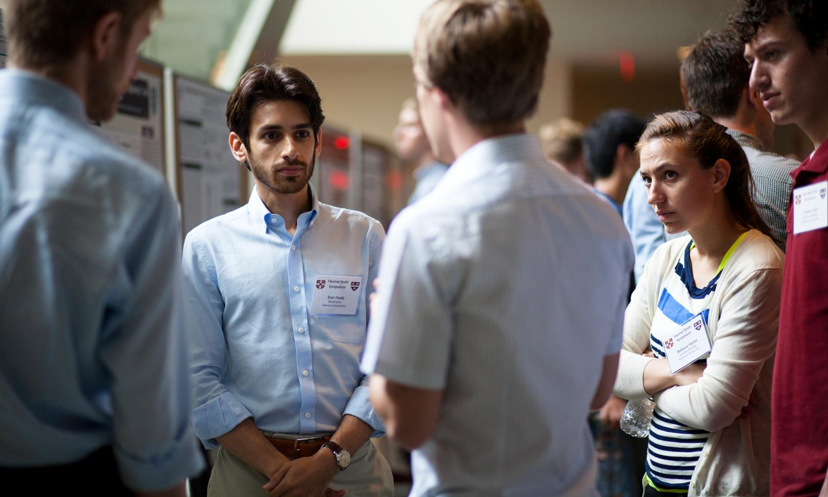 Students confer at the Herschel Smith Symposium
