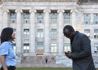 Karina Herrera Gonzalez and Flavian Brown share a laugh on the grounds of the Medical School