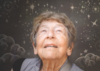 Margaret Kivelson, surrounded by celestial illustrations