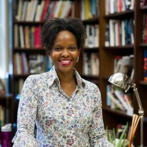 Imani Perry stands in front of bookshelves