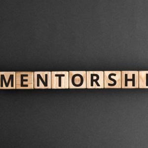 """Scrabble letters spelling out the word """"mentorship"""""""