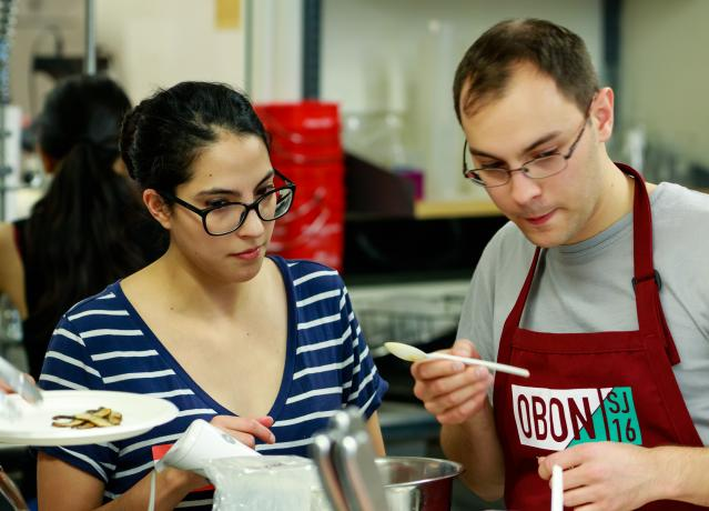 Students participating in the cooking challenge