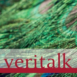 Veritalk logo imposed over peacock feathers